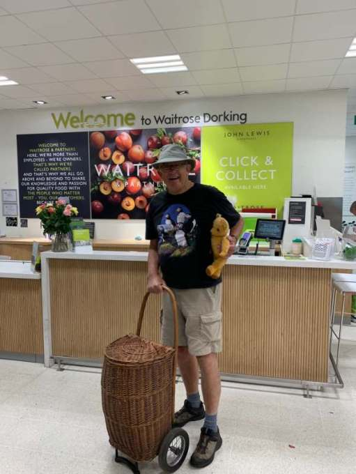Discombobulated: Bobby, with Eamonn under his left arm and his right hand on the Shopping Trolley 'Bobby 2' in Waitrose, Dorking.