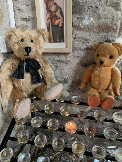 Bertie and Eamonn behind a candle lit for Diddley at St Non's Chapel.