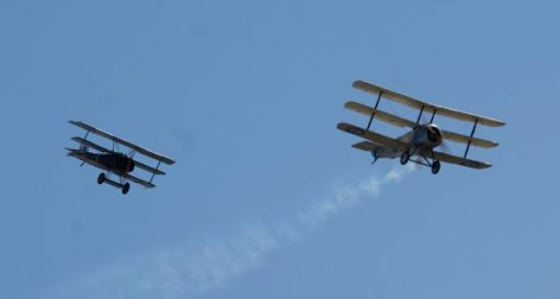 The Fokker Triplane pretending to shoot down the Sopwith Triplane at the Duxford 2019 Airshow.