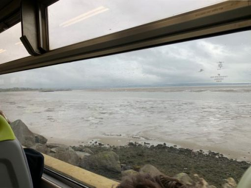 The Burry Inlet near Llanelli. Great windows in a Sprinter. Just two carriages.
