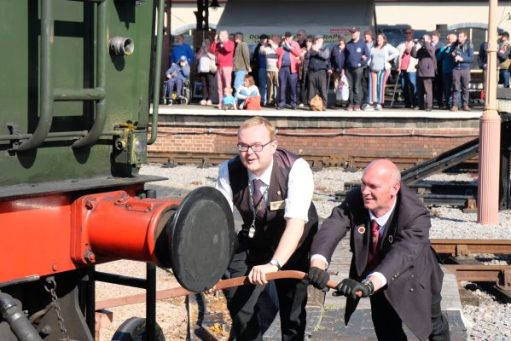 Staff pushing a locomotive on the turntable at Minehead.