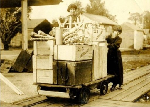 Fireworks loaded on a narrow guage railway truck by a couple of ladies - possibly in the Sutton Factory.