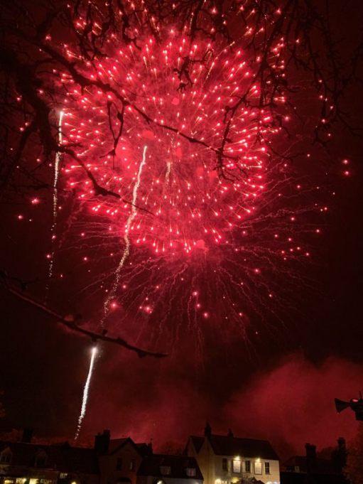 Deep red fireworks over Brockham.