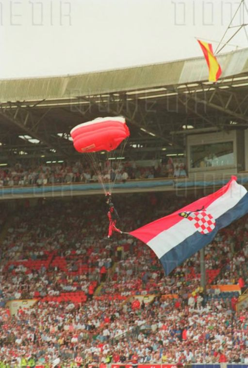 Flags being parachuted in to the stadium.