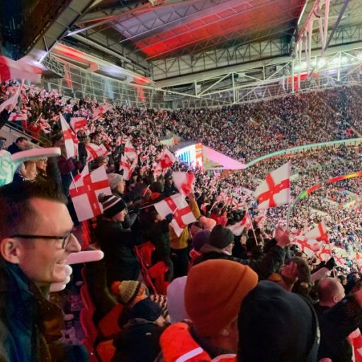 Enthusiastic fans at a packed Wembley Stadium.