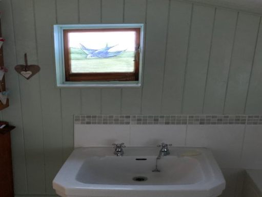 The sink in Bobby's bathroom, under the Bluebird window.