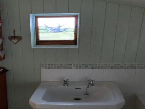 The sink in Bobby's bathroom, under the Bluebird window.