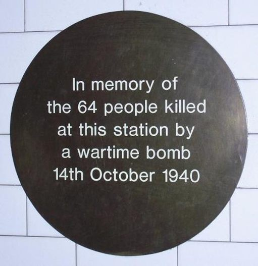 The original plaque referring incorrectly to the 64 people killed.
