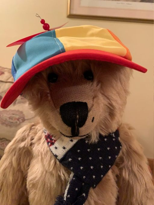 Bertie wearing a bright, multi-coloured cap.
