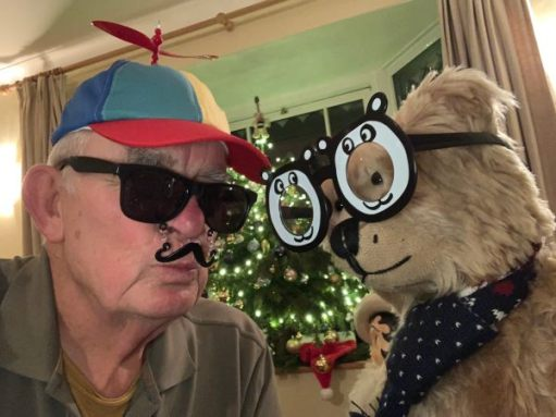 Bertie wearing silly black & white glasses, Bobby wearing a bright, multi-coloured cap with a rotor blade on top, dark sunglasses and a false plastic moustache!