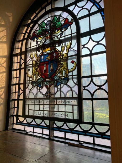 Stained glass window in St Botolphs dedicated to Alderman the Lord Levene of Portsoken KBE, Carman, Lord Mayor 1998-1999.