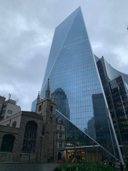 """St Andrew Undershaft. 1532. A rare church that survived both The Great Fire of London and the Blitz.The """"Scalpel"""" towering behind, reflecting the """"Gherkin""""."""