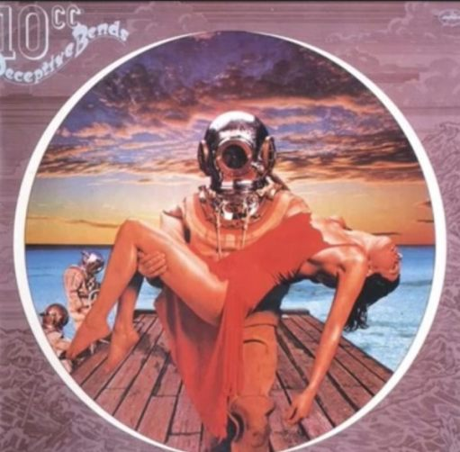 "Album cover of 10cc's ""Deceptive Bends"" - featuring a diver in full gear carrying a lady in a red dress across his arms."