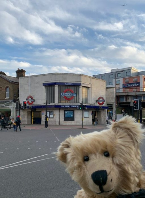 A break from our walking. Bertie poses outside Balham station.