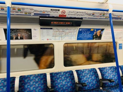 Advertising posters either side of the London Underground map.