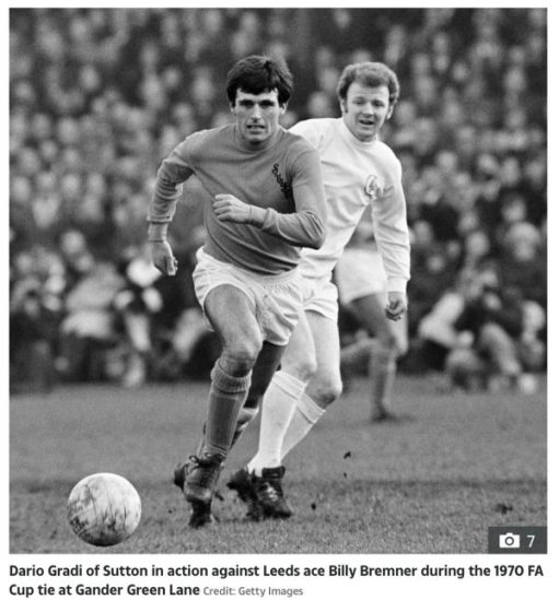 Dario Gradie of Sutton United in action against Leeds Ace Billy Bremner during the 1970 FA Cup tie at Gander Green Lane. Credit Getty Images.