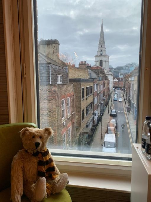 Bertie in the window of room 311, with the view of Fournier Street to Christ Church and Spitalfields.