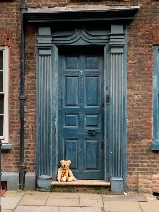 Bertie sat on the threshold of 31 Fournier Street.
