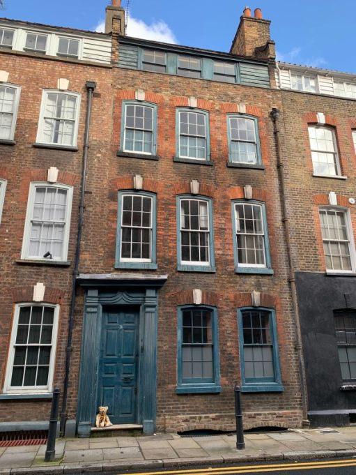 31 Fournier Street. Bertie is sat on the threshold of the fron door.
