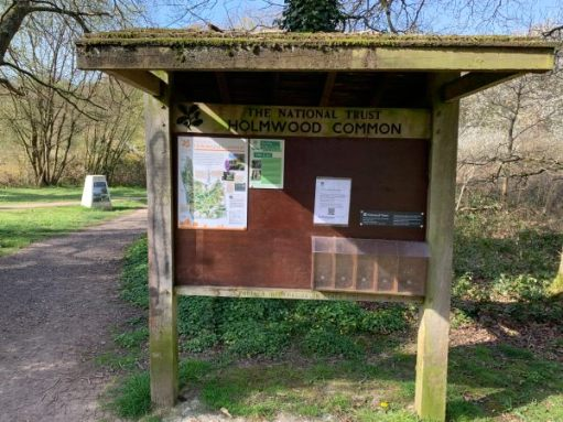 National Trust Notice Board for Holmwood Common. The leaflet dispensers are empty.