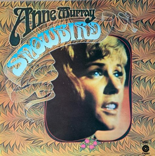 """Album Cover Anne Murray - """"Snowbird"""". A picture of her face within a patterned framing."""