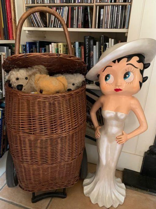 """Bertie, Trevor, Eamonn and Ellen all hiding in """"Bobby 2"""" (a wicker basket on wheels), with Bettie Boop standing alongside."""