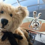 RR Challenge: Close up of Bertie in front of a Rolls-Royce car.