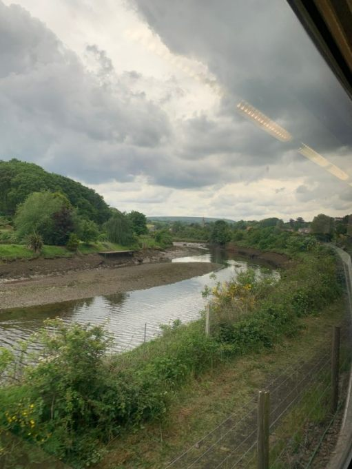 Looking out the train window at the dark threatening clouds over the River Esk.