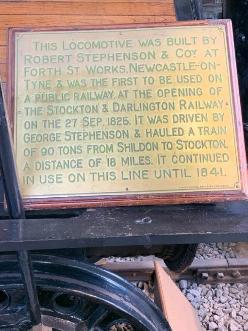 "The brass plaque giving a brief history of ""Locomotion"". The original. Built in 1825. Nearly 200 years old."