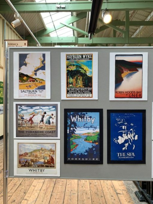 A selection of old railway advert posters.