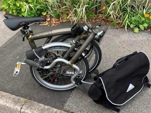 The Brompton folded up on the pavement.