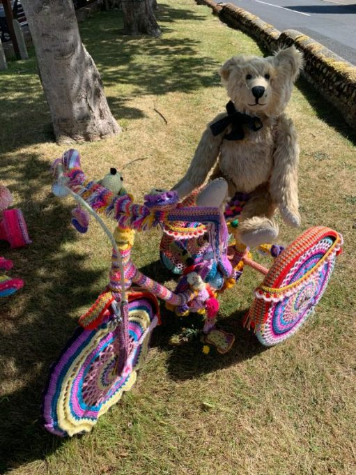 Yarnbomb Sisters - Bertie sat on a knitted tricycle