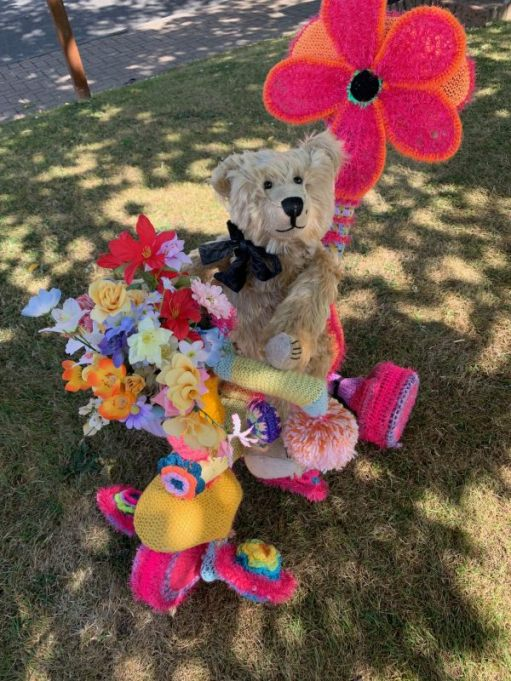 Yarnbomb Sisters - Bertie sat on the knitted toddlers' tricycle