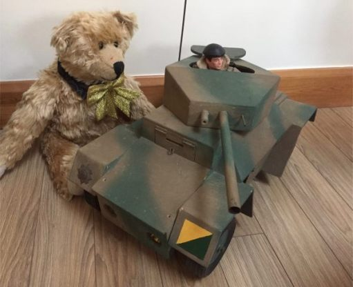 Bertie looking at Bobby's home made Action Man Armoured Car.