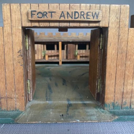 """Looking through the doorway towards the stables of """"Fort Andrew""""."""