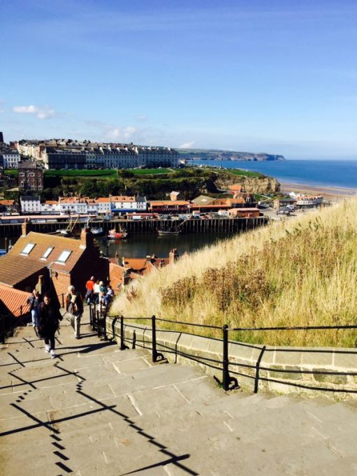 199 down with a glorious view across Whitby Bay. Shallow steps and plenty of seats if you feel puffed.