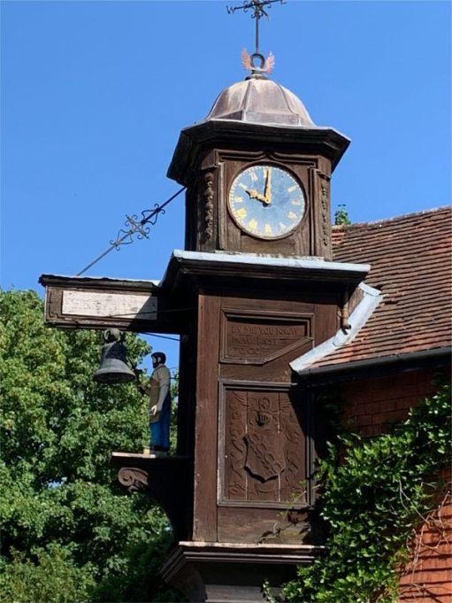 """Jack the Blacksmith"" striking his clock on the hour."