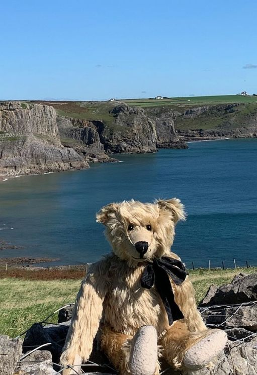 """Fall and Mewslade Bays at high tide. IMPORTANT. Look at the horizon above my left ear. You will see a white cottage, which looks very close to the sea. The cottage is """"Ty Dwr"""" and the subject of the next story from the Gower."""