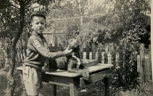1952. Bobby in his wolf cub uniform. He still has that cap. 2nd North Cheam Cub Pack. And Bruce the dog.