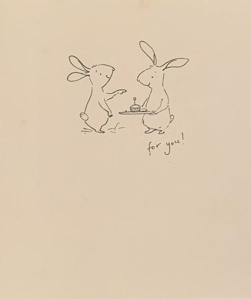 """Two outlined cartoon hares, one offering a cup cake with a candle and saying """"for you""""."""
