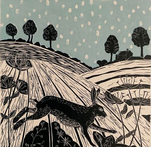 Linocut print of a hare bounding amongst rolling hills.