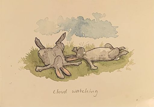 """Drawing of two Hares lying on their backs, with the caption """"Cloud Watching""""."""