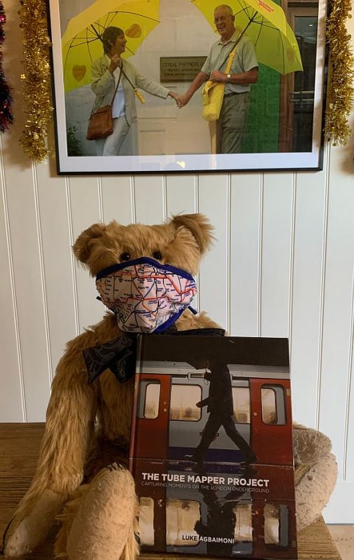"""Bertie wearing an Underground map face mask and showing off the """"Tube Mapper Project"""" book."""