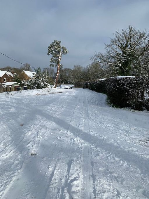 A snowy road in South Holmwood.