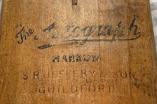 "Close up of more detail: ""The Autograph, Harrow"" and ""SR Jeffery & Son, Sports Depot, Guildford""."