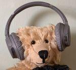 Can you hear me now? Bertie waving headphones.