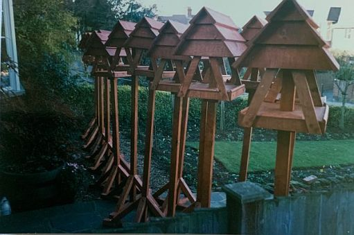 A large number of Bobby's wooden birdhouses ready to be delivered.