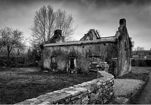 Black and white image of a derelict building.