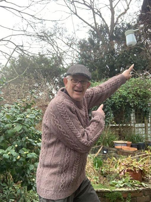 Bobby wearing Wendy's Jumper in the garden.