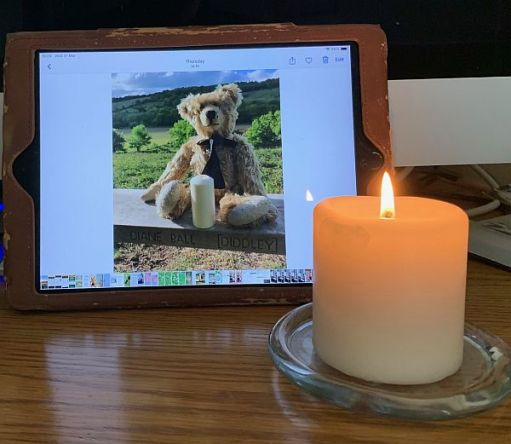 A candle lit for Diddley in front of a candle lit for Diddley in 2018.